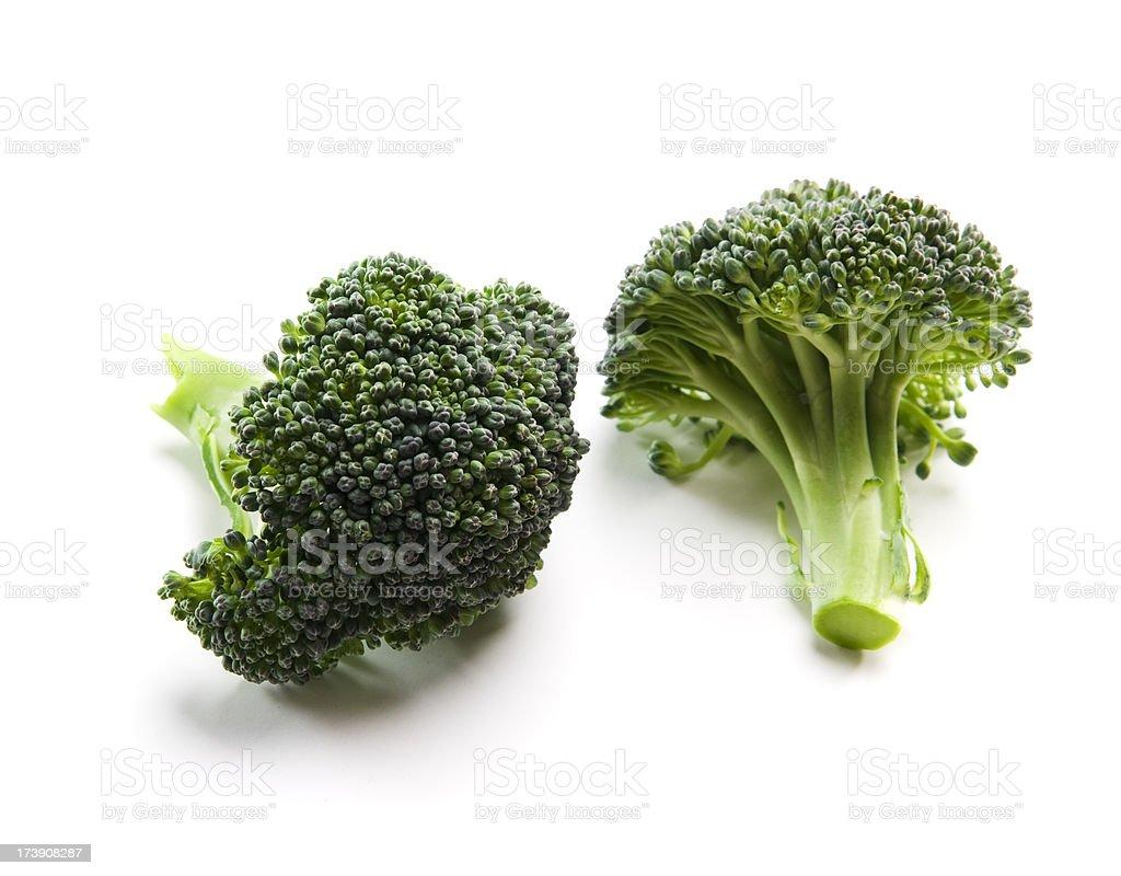 Two organic broccoli florets stock photo