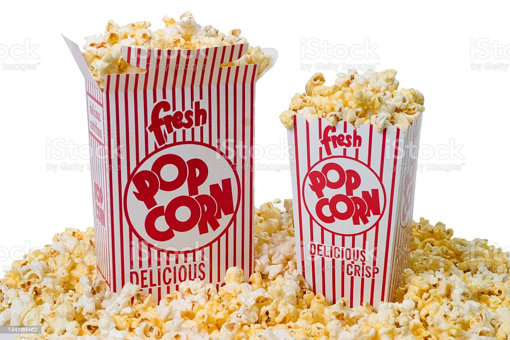 Two overflowing boxes of movie theatre popcorn on popcorn  stock photo