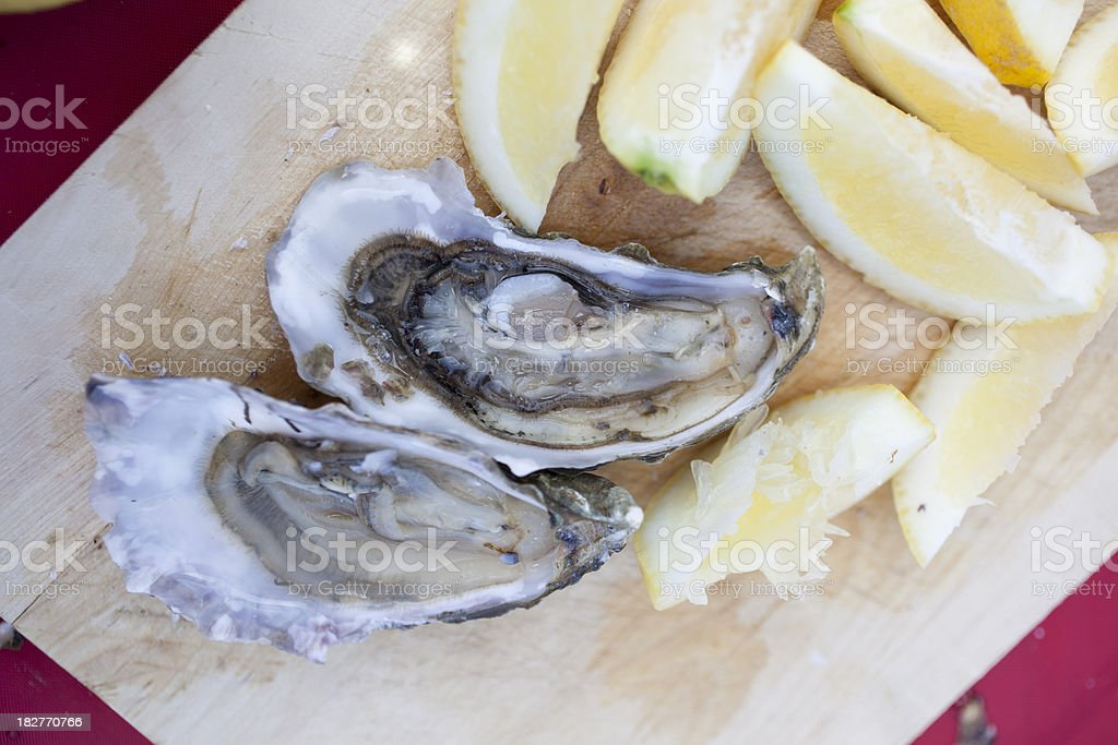 Two Oysters with Lemon Slices stock photo