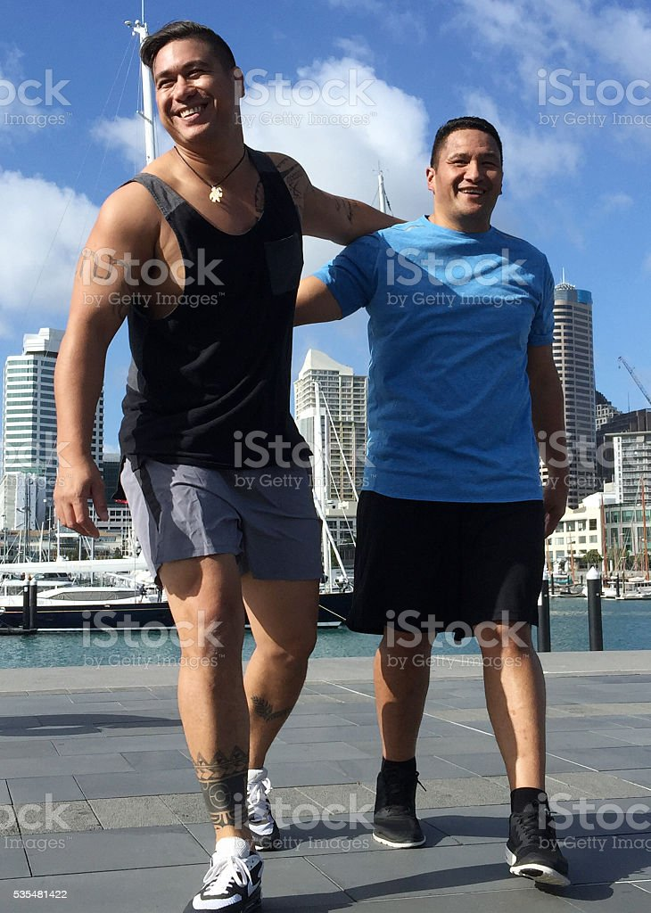 Two Pacific Islander men exercise outdoors stock photo