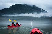 Two paddlers explore Mendenhall Lake in Alaska