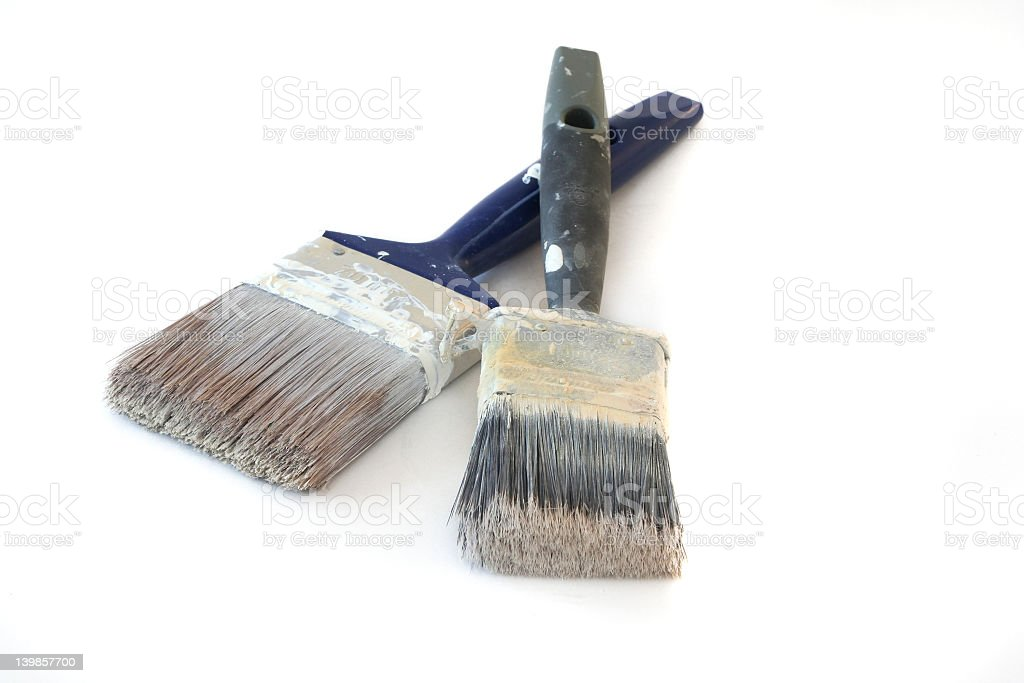 Two paint brushes with old paint royalty-free stock photo