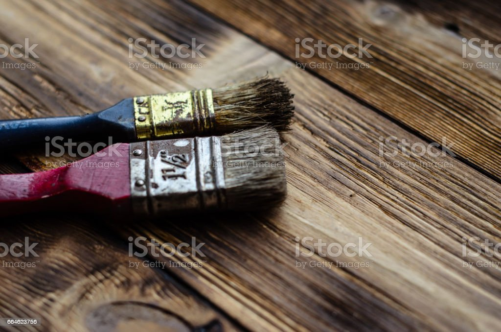 Two paintbrushes on wooden background stock photo