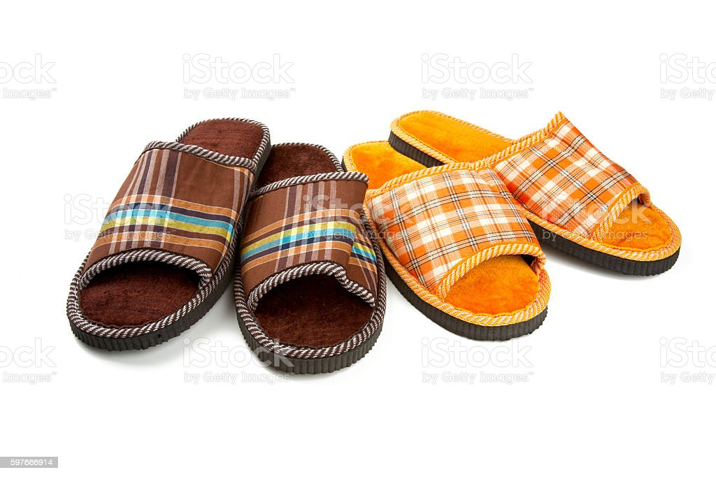 two pairs of slippers isolated on white stock photo