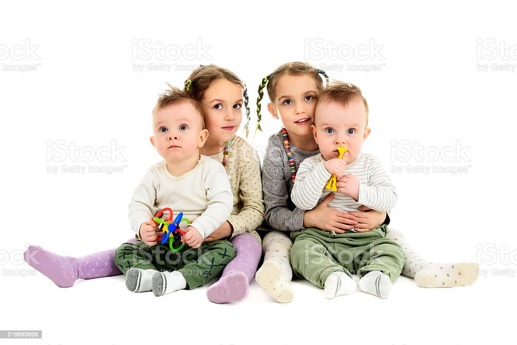 Two pairs, sets of twins - boys and girls. stock photo