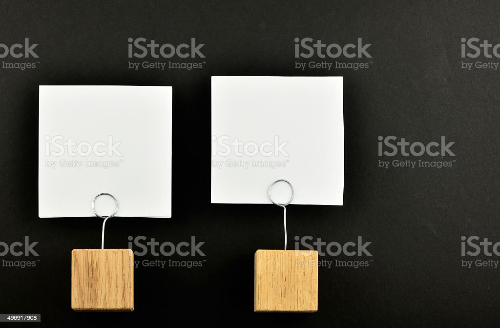 Two paper notes with holders on black background for presentatio royalty-free stock photo