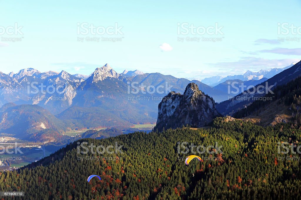 Two paraglider airmen on a mountain stock photo
