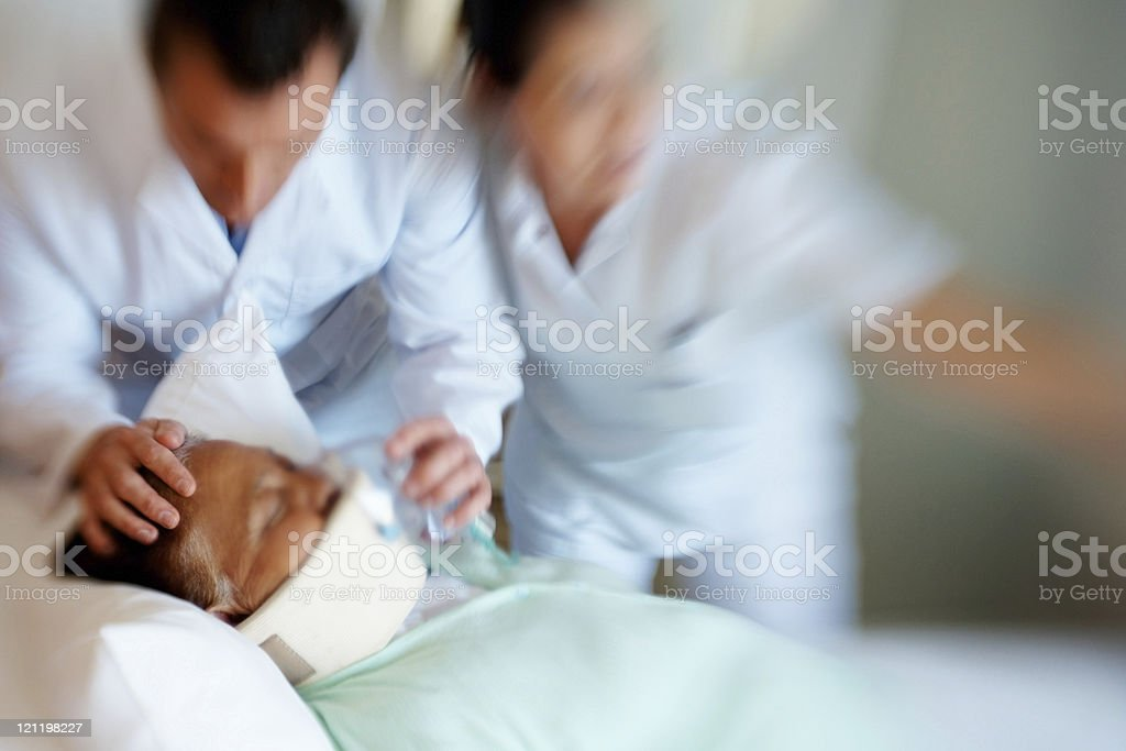 Two paramedics rushing with a patient on stretcher royalty-free stock photo