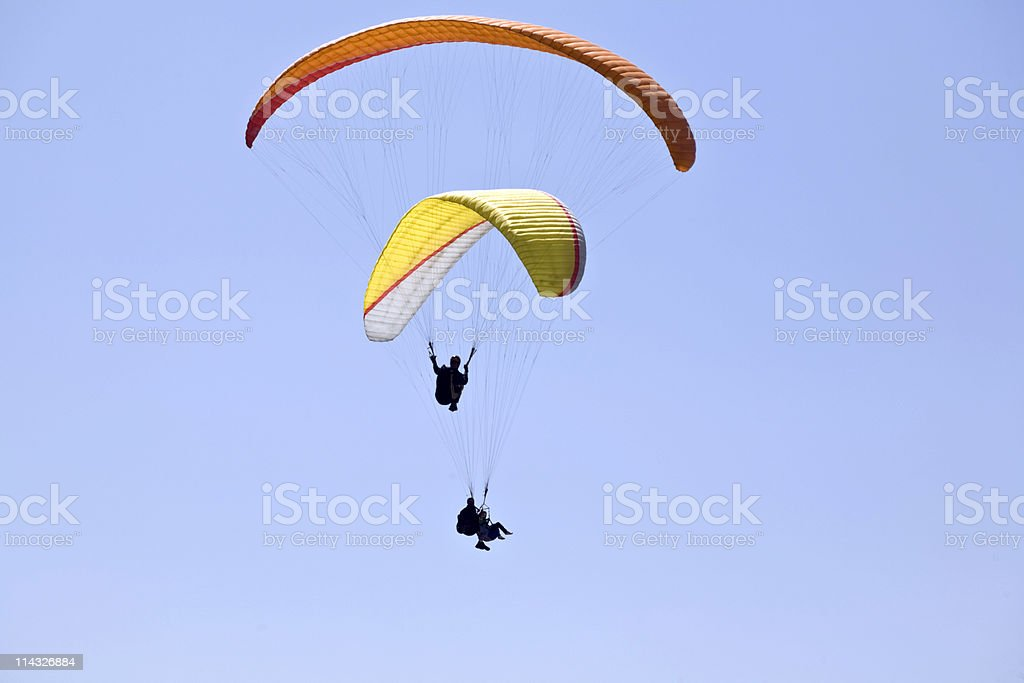 Two parasailers soaring, stock photo