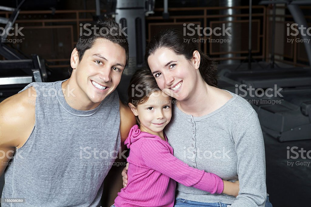 Two parent family in a health club royalty-free stock photo