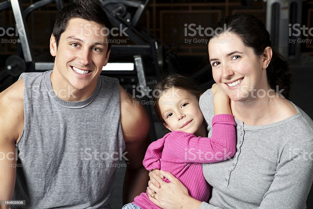 Two parent family in a health club stock photo
