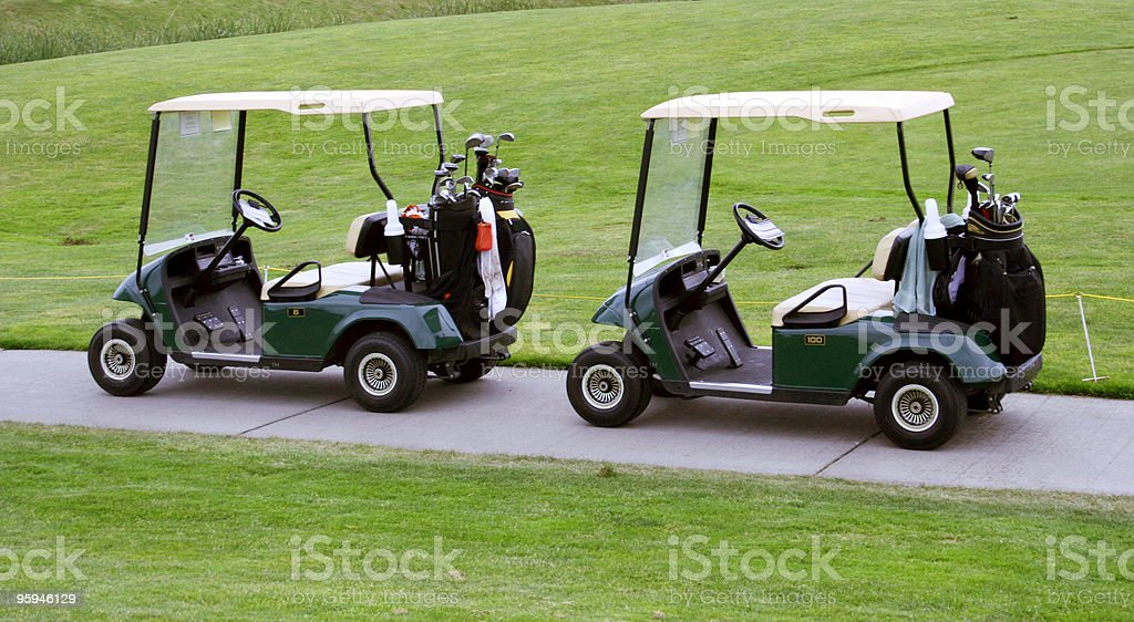 Two Parked Golf Carts. Business Negotiations? stock photo