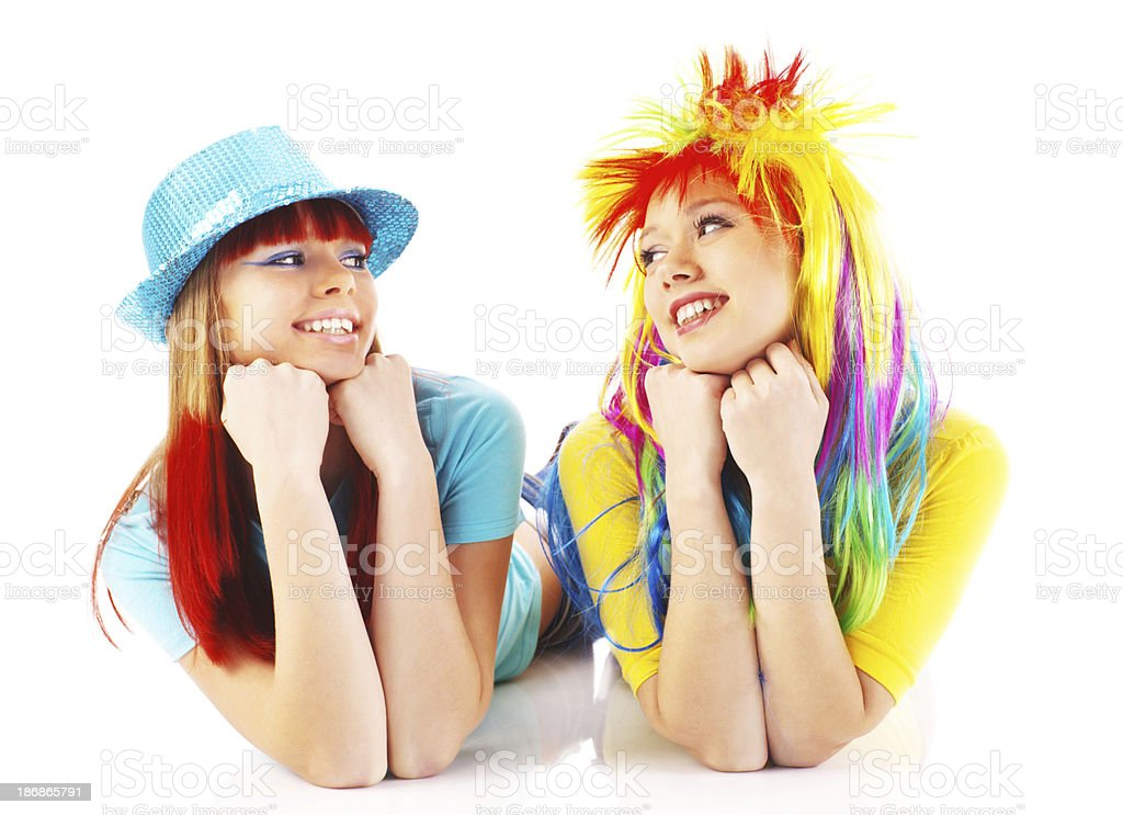 Two party girls looking at each other. royalty-free stock photo