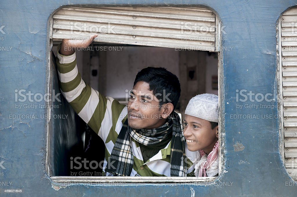 Two passengers at the window of coach, Bangladesh royalty-free stock photo