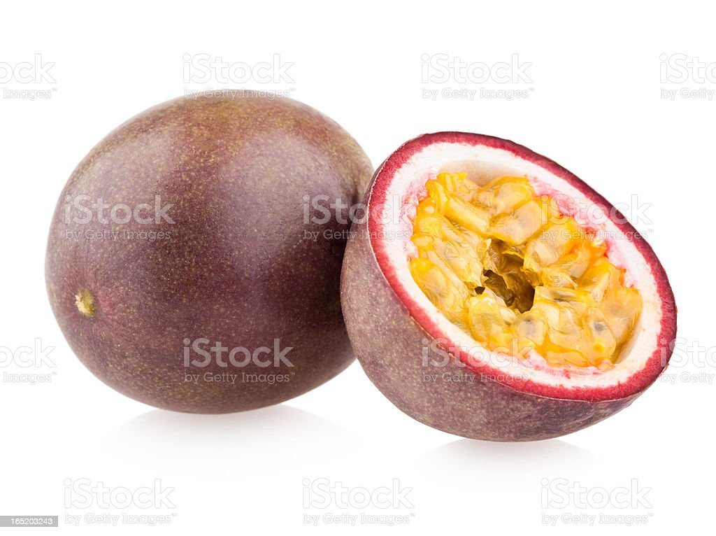Two passion fruits, one sliced and one whole stock photo