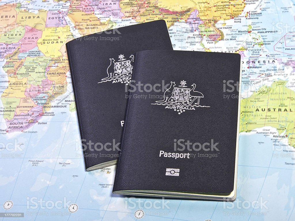 Two passport on a map of the world stock photo
