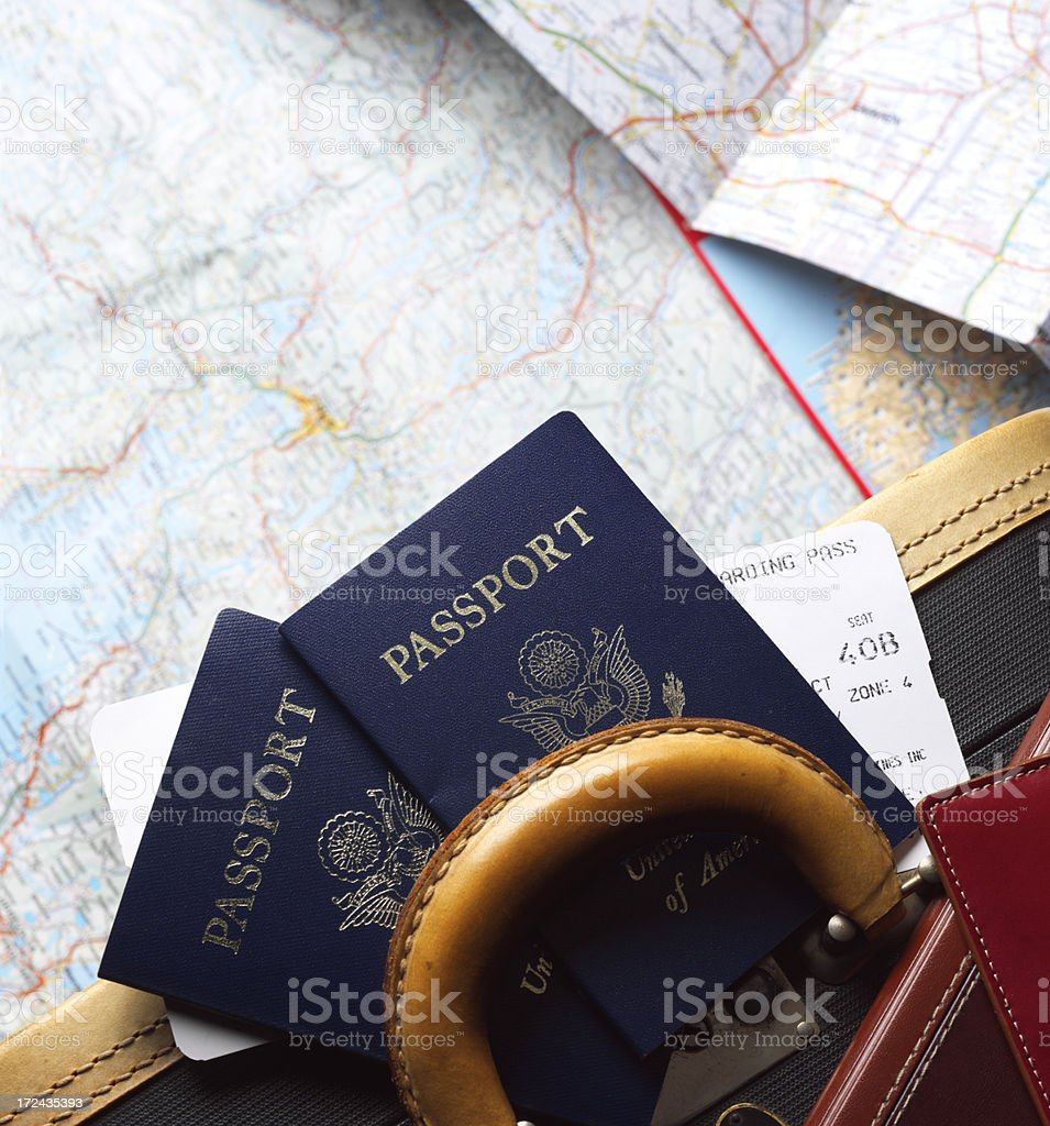 Two passports and airline boarding pass on piece of luggage stock photo
