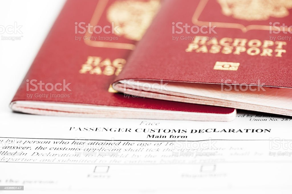 Two passports are on the passenger custom declaration royalty-free stock photo