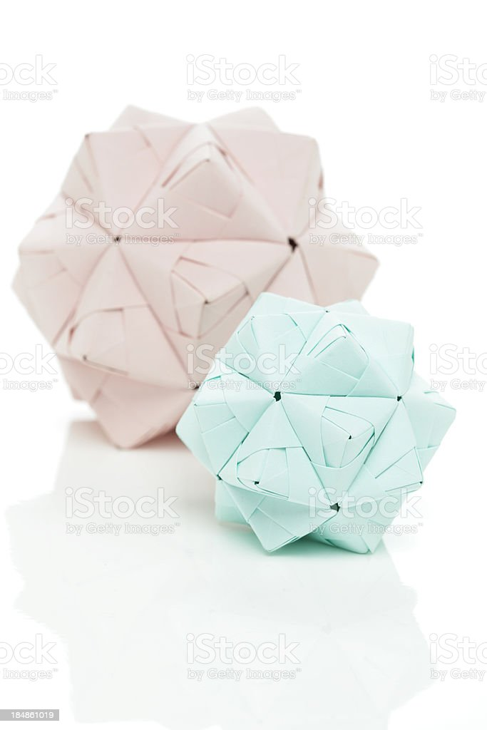 Two pastel origami polyhedron paper craft designs royalty-free stock photo