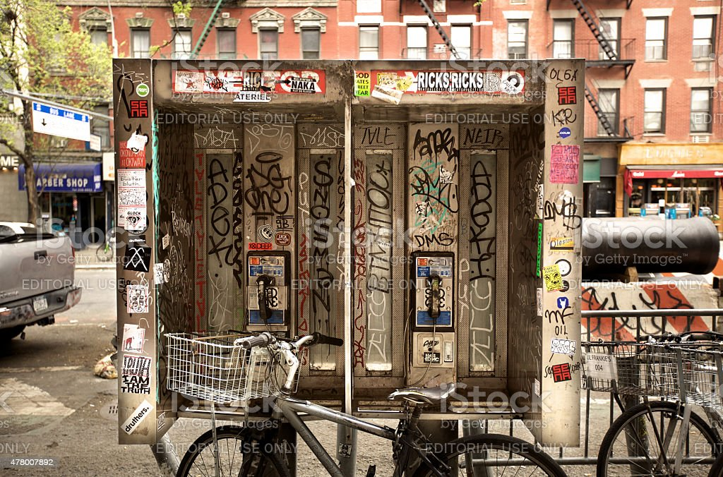 Two payphones with grafitti in New York City stock photo