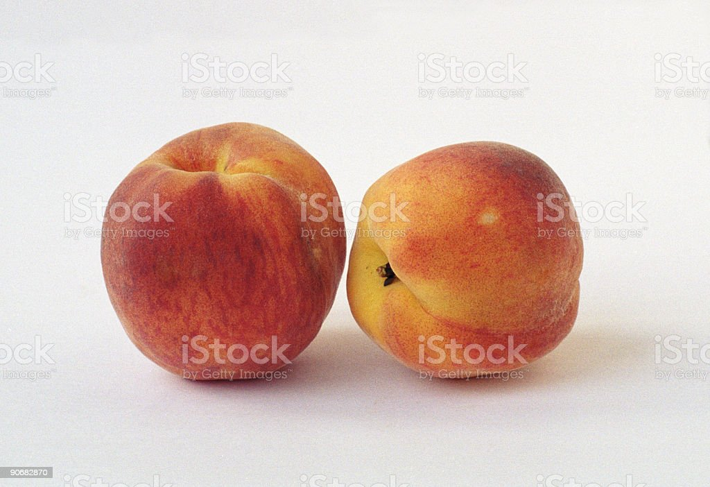 Two peach royalty-free stock photo