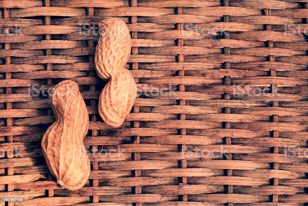 two peanuts with braided background stock photo
