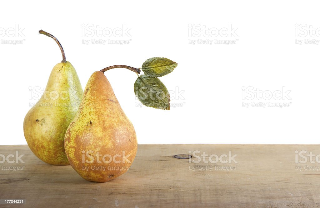 Two pears on a plank stock photo