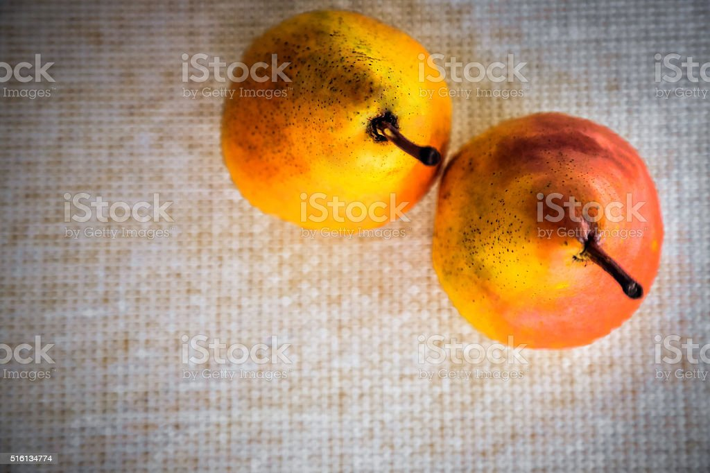 Two Pears on white sisal high angle view stock photo