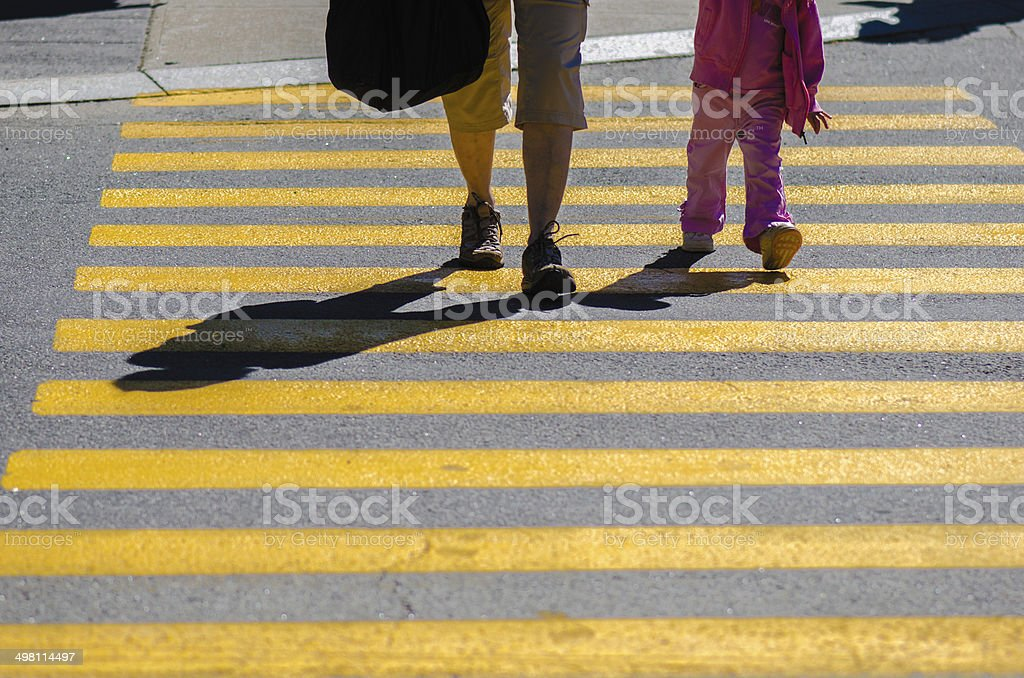 Two Pedestrians crossing stock photo