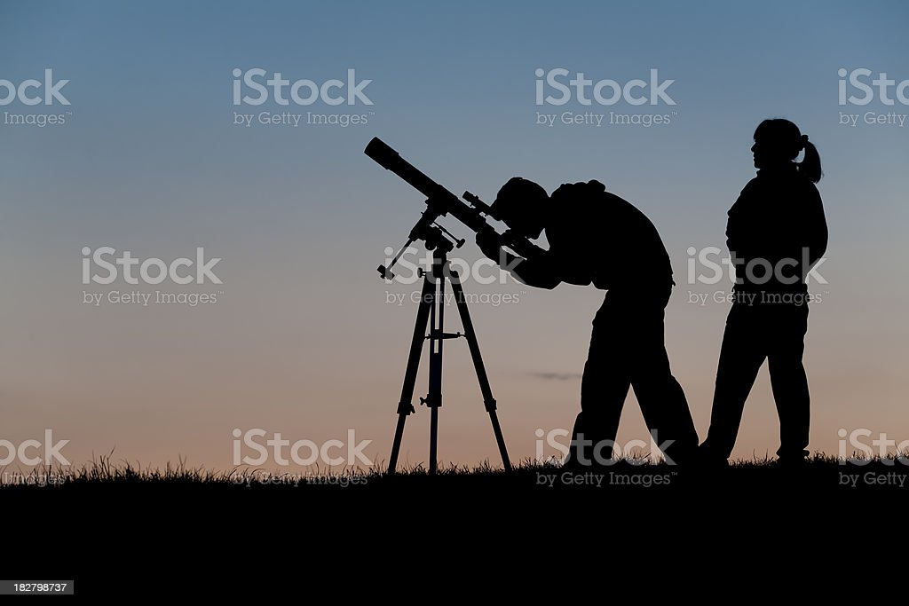 Two people at an astronomy club observing night stock photo