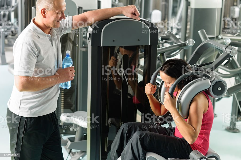Two people at fitness center exercise abdominal royalty-free stock photo