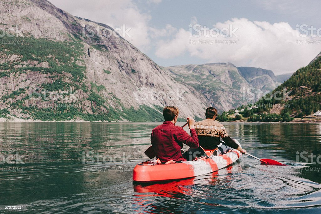 Two people canoeing stock photo
