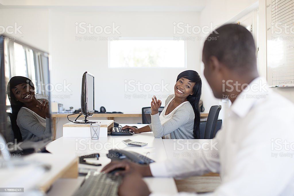 Two People Chatting in the office, South Africa royalty-free stock photo