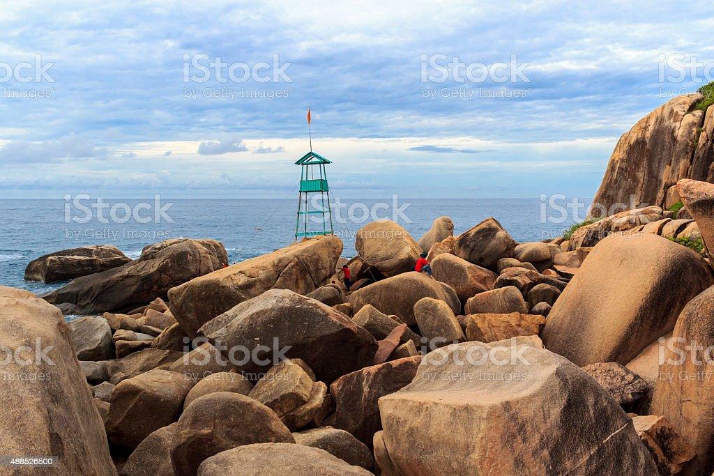 Two people climb on big rocks stock photo