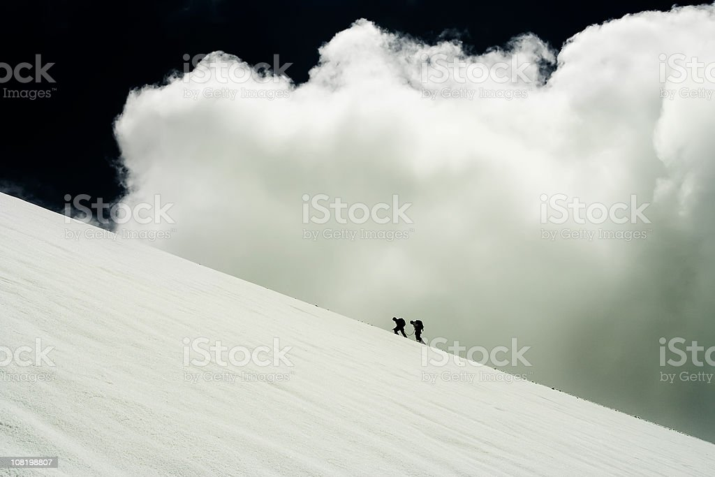 Two People Climbing Mountain Glacier stock photo