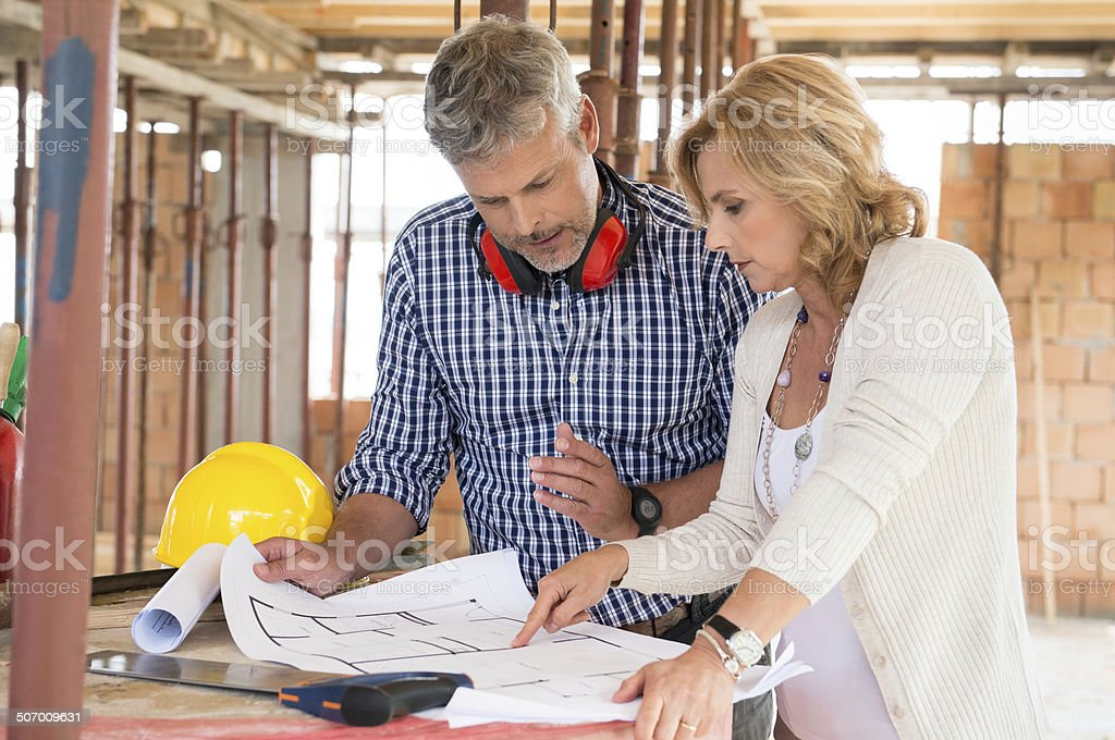 Two People Discussing Plan Project stock photo