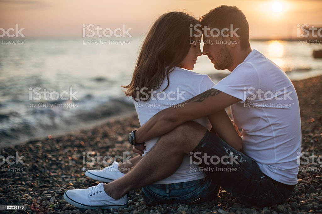 Two people embracing each other stock photo