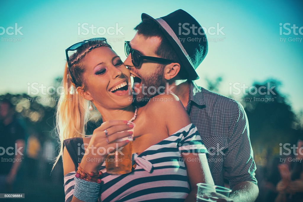Two people enjoying open air concert. stock photo