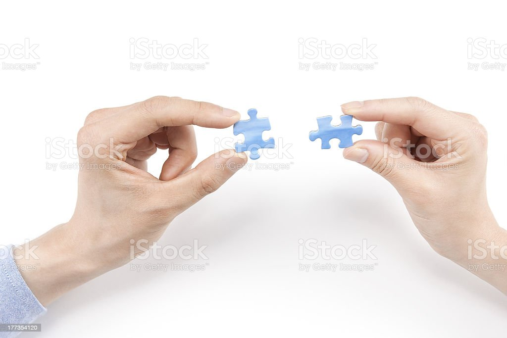 Two people having a puzzle piece royalty-free stock photo