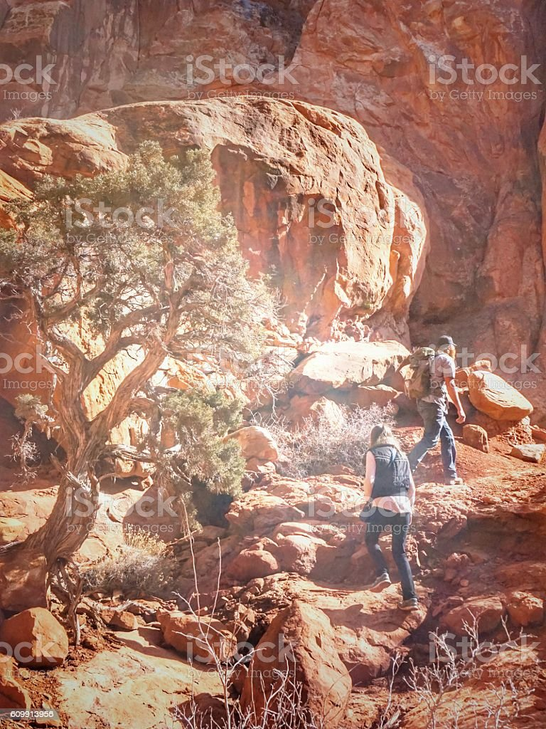 Two People Hiking, Red Rock Fiery Furnace Backcountry, Arches, Utah stock photo
