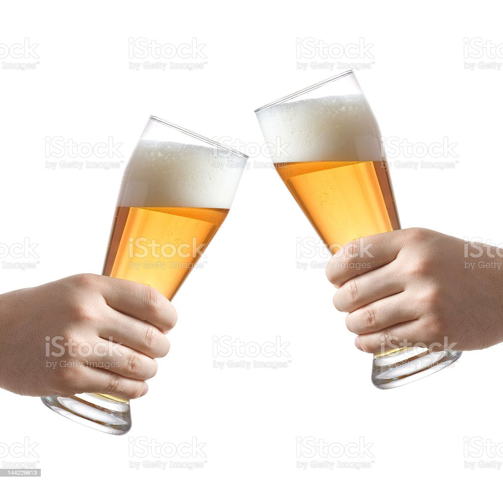 Two people holding a beer glass royalty-free stock photo