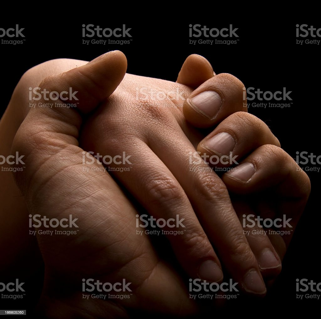 Two people holding each others hands stock photo