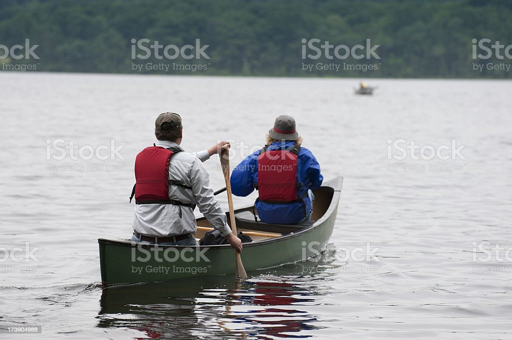 Two People in a Canoe on Lake royalty-free stock photo