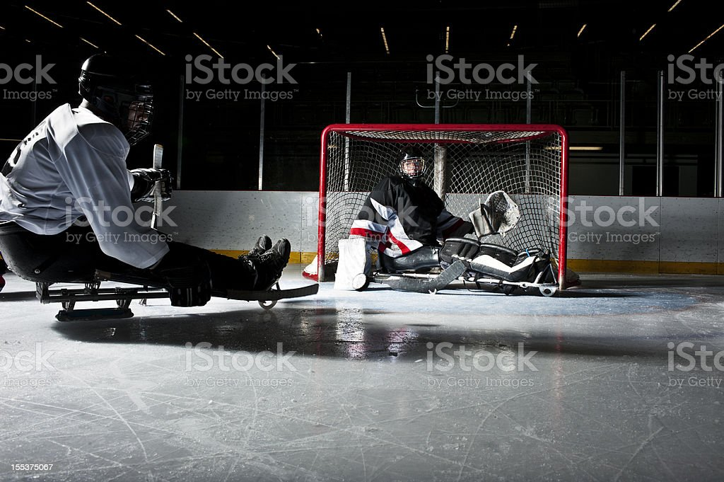 Two people in a hockey game on the ice rink royalty-free stock photo