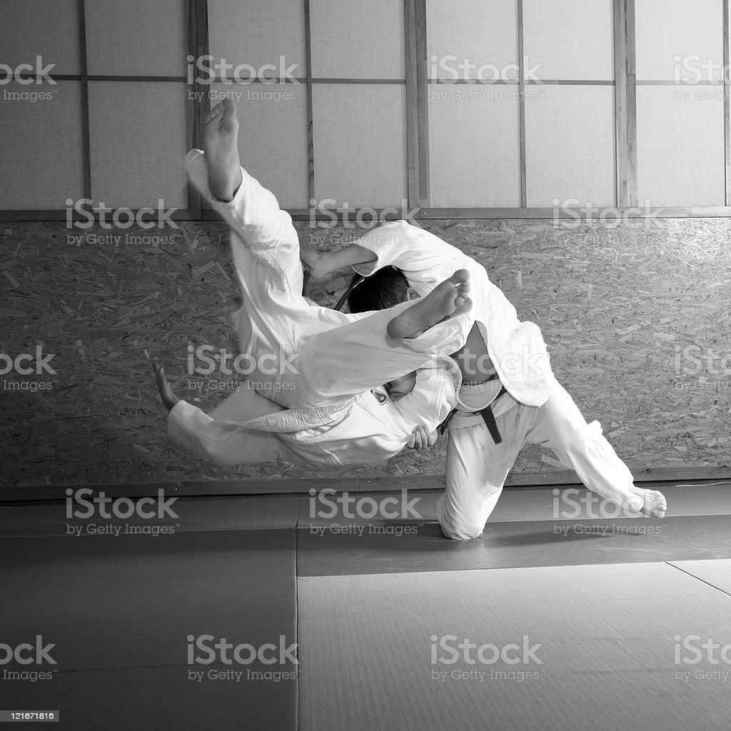 Two people in a judo fight while wearing costume stock photo