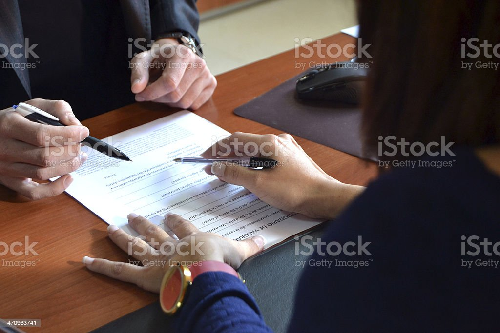 two people in an office stock photo