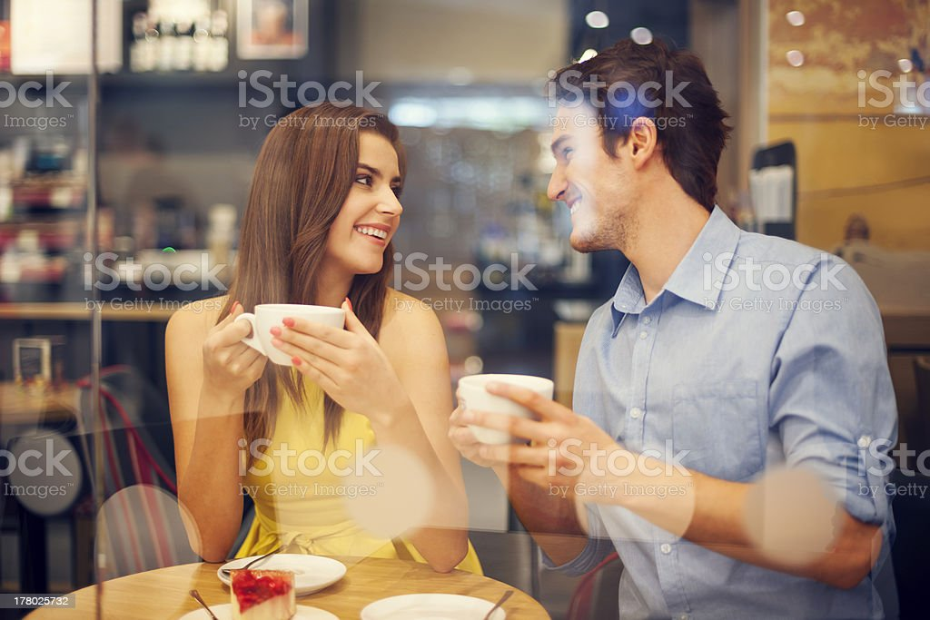 Two people in cafe enjoying the meeting stock photo