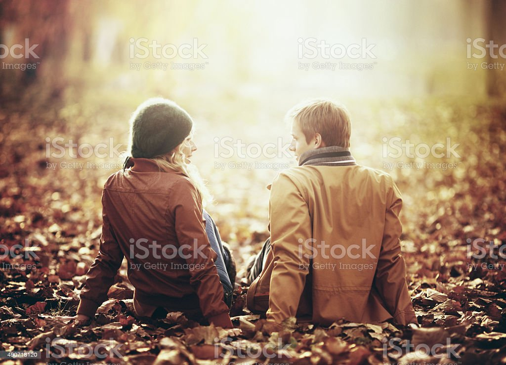 Two people in park on October afternoon. stock photo