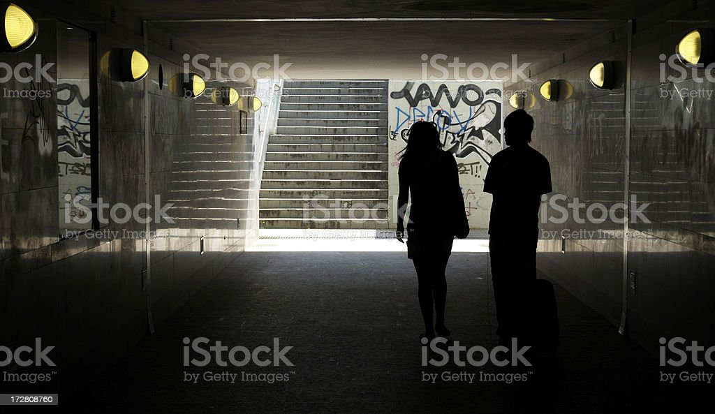 Two people in subway tunnel royalty-free stock photo