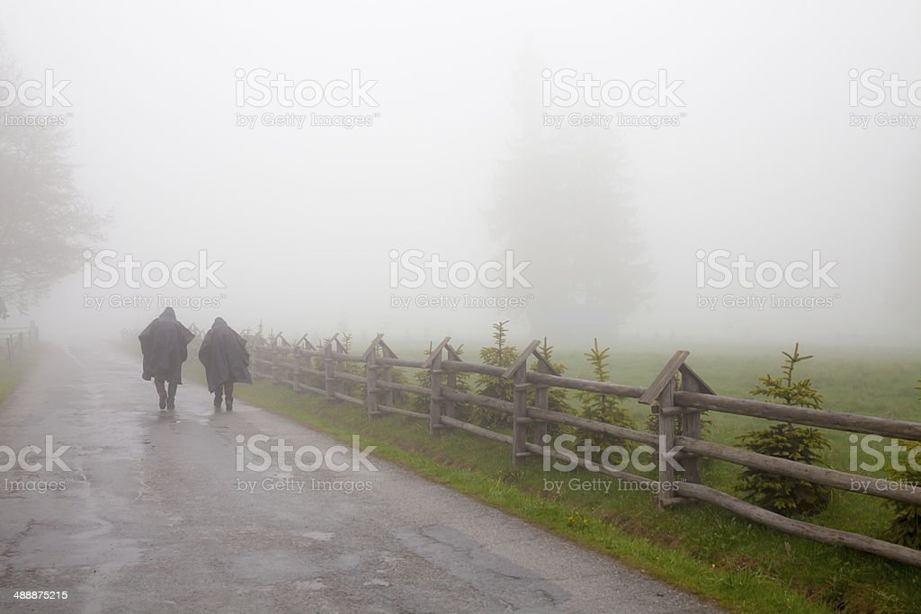 Two people in the fog stock photo